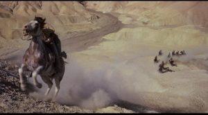 Figures in an arid western landscape in Marlon Brando's One-Eyed Jacks (1961)