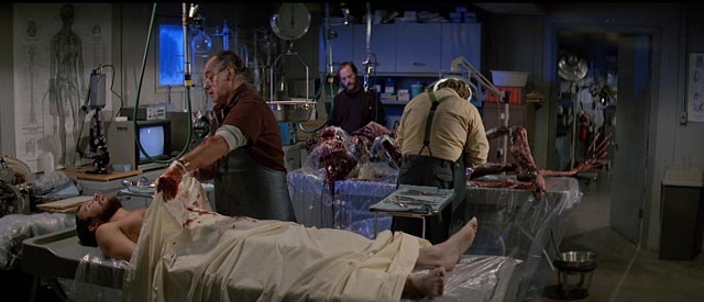 The research team attempt to figure out the nature of the threat in John Carpenter's The Thing (1982)