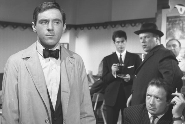 Sammy observed by the two enforcers sent to collect the debt in Ken Hughes' The Small World of Sammy Lee (1963)
