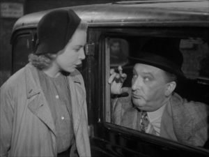 Sally (Deborah Kerr) is approached with an offer by shady businessman Sam Grundy (Frank Cellier) in John Baxter's Love on the Dole (1941)