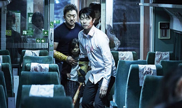 Seok Yoo (Yoo Gong) and Sang Hwa (Dong Seok-ma) trapped on the train in Yeon Sang-ho's Train to Busan (2016)