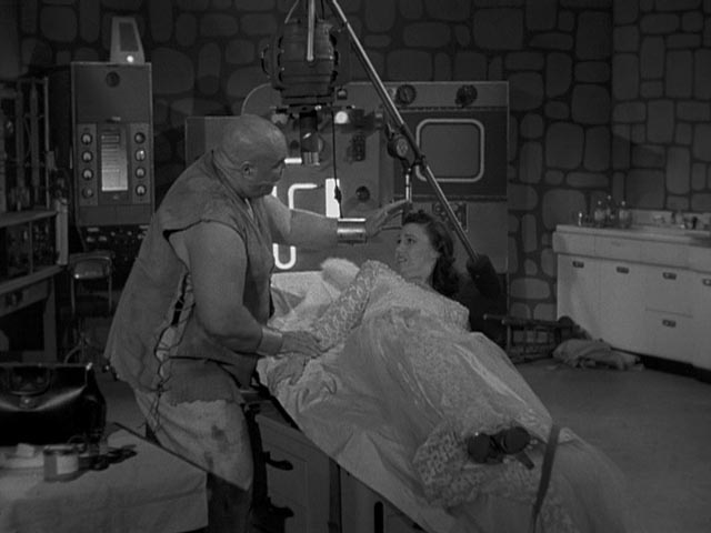 "The ""bride"" (Loretta King) is made uncomfortable by Lobo's expressions of affection in Edward D. Wood Jr's Bride of the Monster (1955)"