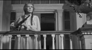Bette Davis as Charlotte, defending her estate from the State's demolition crew in Robert Aldrich's Hush ... Hush, Sweet Charlotte (1964)