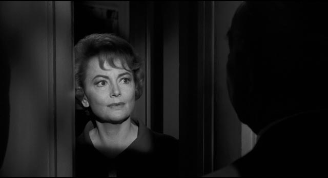 Olivia de Havilland as Charlotte's sweet and concerned cousin Miriam in Robert Aldrich's Hush ... Hush, Sweet Charlotte (1964)