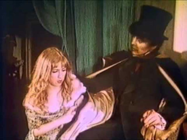 Hyde gets rough with singer April Conners (Julia Stratton) in Andy Milligan's The Man With Two Heads (1972)