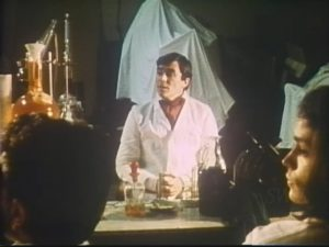 Jekyll lectures his students about the bio-chemical nature of evil in Andy Milligan's The Man With Two Heads (1972)