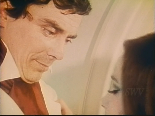 Jekyll tries to placate his fiancee Mary Anne (Gay Field) while simultaneously brushing her off in Andy Milligan's The Man With Two Heads (1972)