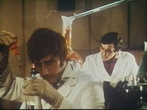 Assistant Jack Smithers (Berwick Kaler) attempts to fix the formula he's messed up in Andy Milligan's The Man With Two Heads (1972)