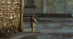 Minek (Omar Brignoli) walking to school in Ermanno Olmi's The Tree of Wooden Clogs (1978)