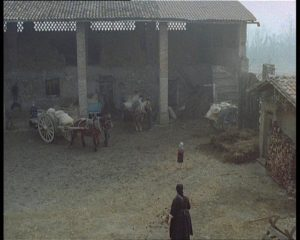 The courtyard of the farmhouse in Ermanno Olmi's The Tree of Wooden Clogs (1978)