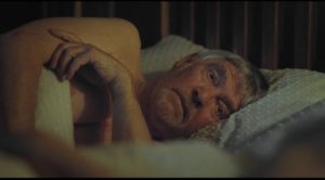 Geoff is haunted by the emotional weight of a past he had suppressed in Andrew Haigh's 45 Years (2015)