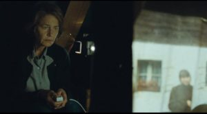 Kate discovers Geoff's unshared secret in old images stored in the attic in Andrew Haigh's 45 Years (2015)