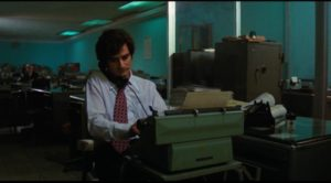 A reporter takes the call about the lynching in the opening scene in Felipe Cazals' Canoa: A Shameful Memory (1976)