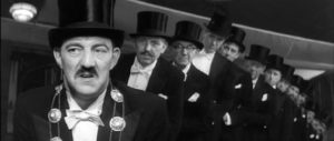 The mayor (Bryan Pringle) and council are unsure whether they're being mocked in Ken Russell's French Dressing (1964)