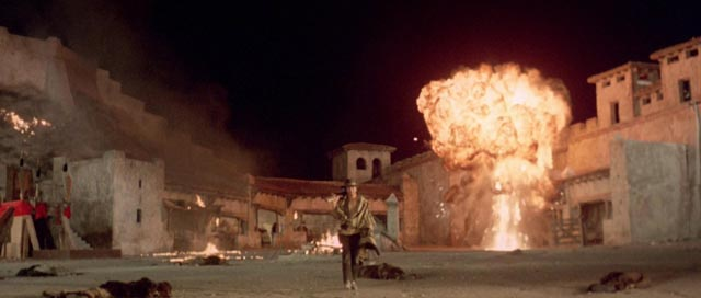 Poducer-star Tony Anthony as the unnamed Stranger during the explosive climax of Ferdinando Baldi's Get Mean (1975)