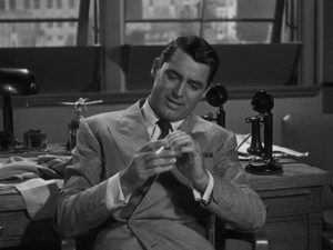 Totally self-centred, editor Walter Burns (Cary Grant) plays it cool in Howard Hawks' His Girl Friday (1940)