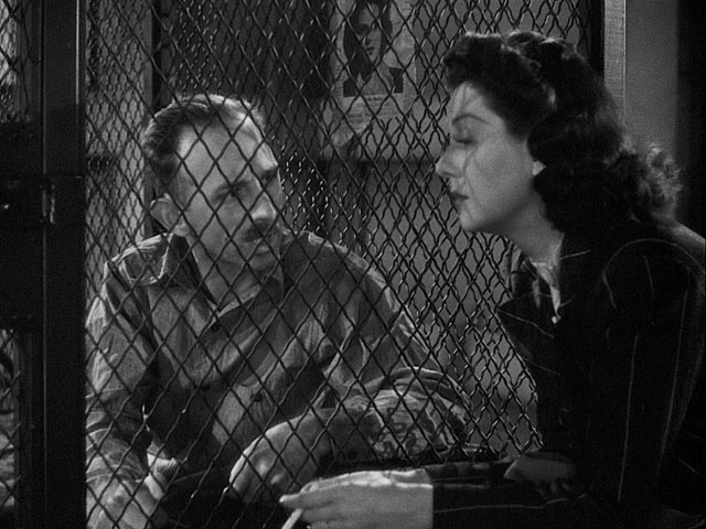 Hildy plays sympathetic to get an exclusive interview with condemned man Earl Williams (John Qualen) in Howard Hawks' His Girl Friday (1940)