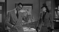 Walter Burks (Cary Grant) tries to railroad ex-wife Hildy Johnson (Rosalind Russell) into staying with the newspaper in Howard Hawks' His Girl Friday (1940)