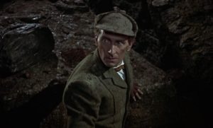 Peter Cushing as Sherlock Holmes, confronting evil in Terence Fisher's The Hound of the Baskervilles (1959)