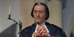 Peter Cushing as Dr. Blyss, the village priest in Peter Graham Scott's Night Creatures (1962)