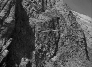 Kilgallen's plane circles the mesa looking for a landing spot in Howard Hawks' Only Angels Have Wings (1939)