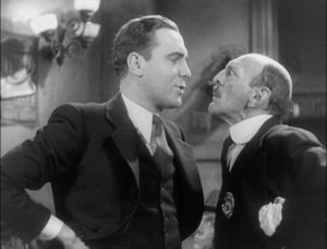 Hildy (Pat O'Brien) faces down corrupt Sheriff Hartman (Clarence Wilson) in Lewis Milestone's The Front Page (1931)