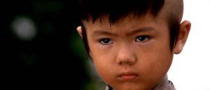 Akihiro Tomikawa as Daigoro, silent witness to a world of relentless violence in Kenji Misumi's Baby Cart to Hades (1972)