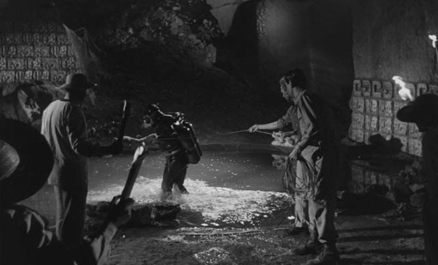 The archaeologists prepare to explore the deep pool inside the cave in Mario Bava & Riccardo Freda's Caltiki: The Immortal Monster (1959)