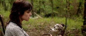 Ada (Lauren Ashley Carter) discovers her unwanted fate in Chad Crawford Kinkle's Jug Face (2013)