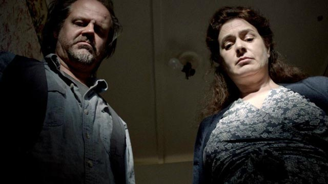 Larry Fessenden and Sean Young as Ada's parents, servants of an unforgiving god in Chad Crawford Kinkle's Jug Face (2013)