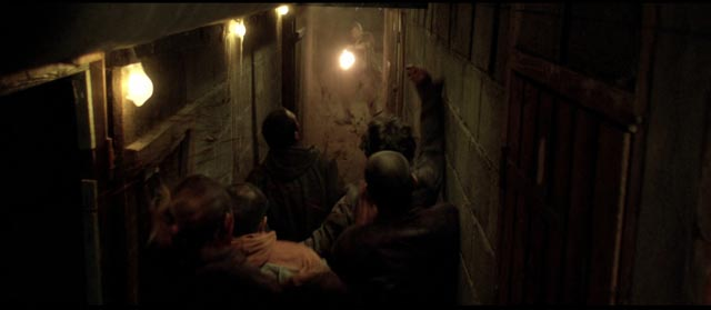 Zombies in tight spaces in Yannick Dahan & Benjamin Rocher's La horde (2009)