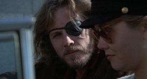Alex Cutter (John Heard), the embittered Vietnam vet with a money-making plan in Ivan Passer's Cutter's Way (1981)