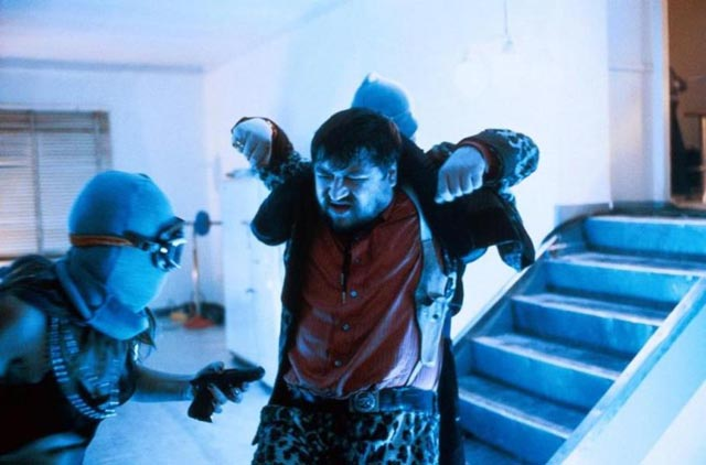 Jensen attacked by fetish-dressed assassins in Wolf Gremm's Kamikaze '89 (1982)