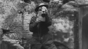 An army cameraman films horrors in Germany at the end of WW2, in Andre Singer's Night Will Fall (2014)