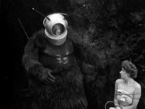 Ro-Man menacing one of the few survivors of an alien attack in Phil Tucker's Robot Monster (1953)
