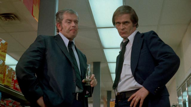 Lomax (Ray Green) and Steele (Jack Canon) indulge in some unmotivated nastiness in Frederick R. Friedel's Axe (1974)