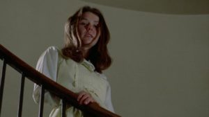 A classic use of the staircase to establish power relations in Frederick R. Friedel's Axe (1974) ...