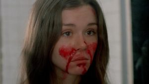 Lisa (Leslie Lee) contemplates her own madness in Frederick R. Friedel's Axe (1974)