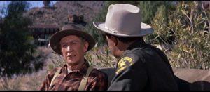 Martin (Cornel Wilde) questions Eli Jones (Tom Fadden) about the murder in Don Siegel's Edge of Eternity (1959)
