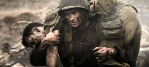 Medic Desmond Doss (Andrew Garfield) rescues one more wounded man in Mel Gibson's Hacksaw Ridge (2016)