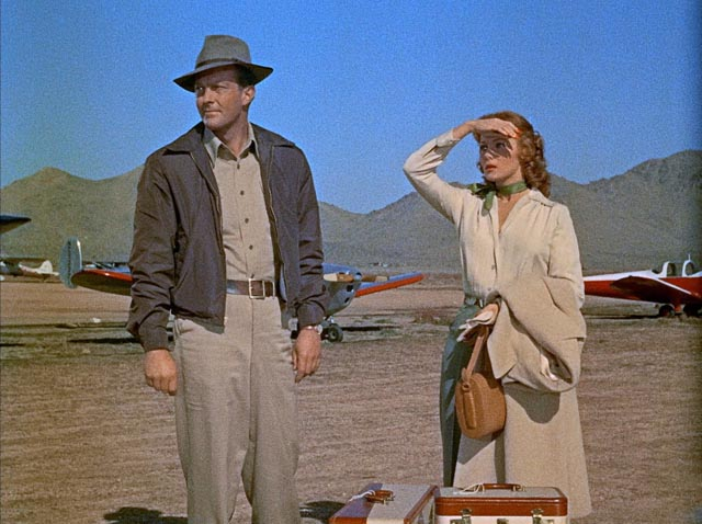 Geraldine Carson (Rhonda Fleming) and Joseph Duncan (William Lundigan) abandon her injured husband to his fate in Roy Ward Baker's Inferno (1953)