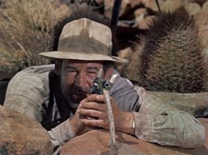 Carson (Robert Ryan) takes aim at some food in the desert in Roy Ward Baker's Inferno (1953)
