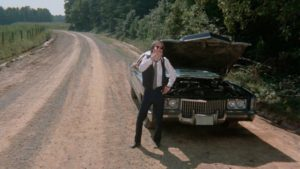 At the mercy of contingency: Eddie (Jack Canon) contemplates the breakdown in the middle of nowhere in Frederick R. Friedel's Kidnapped Coed (1975)