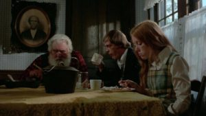 The hospitality of the old man (Charles Elledge) conceals other kinds of madness in Frederick R. Friedel's Kidnapped Coed (1975)