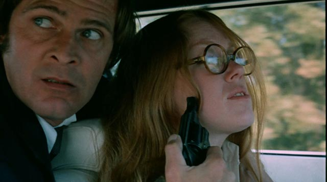 Student Sandra (Leslie Ann Rivers) and her abductor Eddie (Jack Canon) in Frederick R. Friedel's Kidnapped Coed (1975)