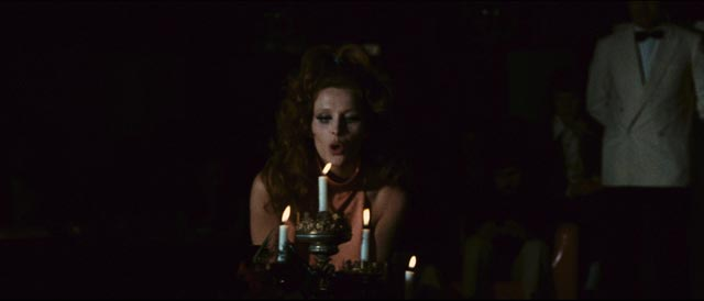 Erika Blanc emerges from a coffin for a kinky strip routine at a decadent club in Emilio P. Miraglia's The Night Evelyn Came Out of the Grave (1971)