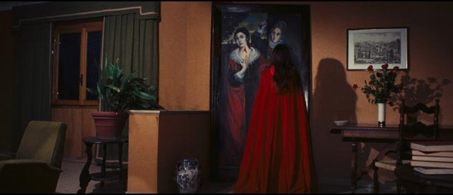The apparently reincarnated Red Queen contemplates the sinister painting of the family curse in Emilio P. Miraglia's The Red Queen Kills Seven Times (1972)