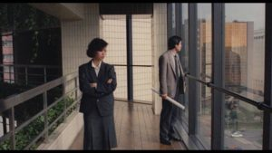 Figures in architectural spaces: Chin and her co-worker in Edward Yang's Taipei Story (1985)
