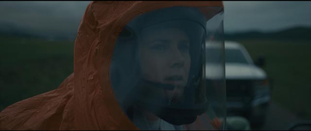 Academic linguist Louise Banks (Amy Adams) gets her first view of the alien craft in Denis Villeneuve's Arrival (2016)