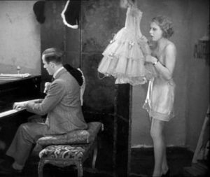 In the sound version of Alfred Hitchcock's Blackmail (1929), during his seduction attempt, the Artist (Cyril Ritchard) plays the piano ...